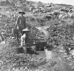 Chinese gold miners working a small stream