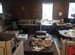 A cot, squeezed in among office cubicles at a child abuse hotline office, where a teen slept back in June 2016.