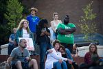 PSU student Donald Thompson III bows his head during a moment of silence for Jason Washington.