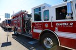 70 fire trucks and emergency responder vehicles led a procession to honor Battalion Chief Mickel Zainfeld.