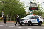 Portland police respond to reports of a person with a gun near Parkrose High School in Portland, Ore., on Friday, May 16, 2019.