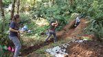 Portland State University researchers Alexis Judy (left), Lana Jewell, and Alison Horst (right) hand excavating a trench across the Gales Creek fault.