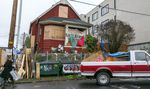 """Activists at the """"red house"""" put out a call on Sunday morning, Dec. 13, 2020, asking for help to remove barricades after it was announced that city had reached a tentative deal with the owners of the home."""