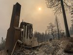 Retrofitting homes with fire-resistant materials can improve the chances they survive wildfires. Here, a home is destroyed after the Creek Fire swept through the area near Shaver Lake, Calif.