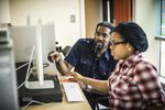 Professor Tewodross Melchishua Williams works with an Animation and Motion Graphics student at Bowie State University.