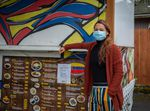 Verónica Gutiérrez poses for a portrait in front of her food cart, La Arepa, at the Portland Mercado in SE Portland, Ore., on Wednesday, May 20, 2020. La Arepa specializes in Venezuelan cuisine.