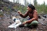 Marcela Fernandez holds crystals from other glaciers she's visited Sunday, Oct. 18, 2020.