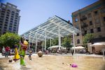 Children play in the splash zone at Director Park in downtown Portland.