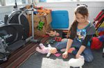 Ten-year-old Azul plays with her pet rabbit at her family's home in Wapato, Washington.