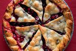 """Bake this brightly flavored, nuts-optional seasonal Cranberry Pie until the crust is just golden or you see steady bubbling coming out of the vents. From """"Art of the Pie"""" by Kate McDermott."""
