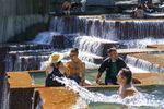 Dozens of people sat and played in the Ira Keller Fountain Park in Portland, June 28, 2021.