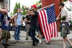 Patriot Prayer leader Joey Gibson directs people back to the west side of the Willamette River during demonstrations in Portland, Ore., Saturday, Aug. 17, 2019.