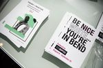 Programs for the Be Nice (White) You're In Bend exhibit on display at Scalehouse in Bend, Ore., on Aug. 6, 2021.