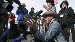 "Robert ""LaVoy"" Finicum holds up an FBI surveillance camera the occupiers dismantled during their time at Malheur National Wildlife Refuge."