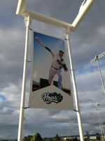A Hillsboro Hops banner is displayed outside the stadium before the home opener.