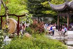 People watch Portland Taiko perform at Lan Su Chinese Garden to celebrate Asian-Pacific American Heritage Month in 2017. The garden had four performances each weekend throughout May from cultural groups representing a wide variety of Asian and Pacific nations.