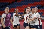 The U.S. team celebrates after winning the Tokyo 2020 Olympic Games women's quarter-final soccer match between Netherlands and the U.S. on July 30, 2021.