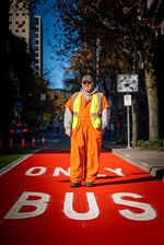 Vincent Edmonson stands for a portrait on the newly painted transit lane that is part of PBOT's effort to make bus, streetcar, and train service better.