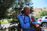 Delson Suppah Sr. enjoys the shade and the company near the village pool at Kah-Nee-Ta.