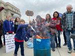 Families gathered at the Idaho Capitol building on Saturday, March 6, 2021, to burn masks at a protest over COVID-19 restrictions.