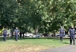 Medford police at Hawthorne Park in Medford, Ore., on Tuesday, Sept. 22 while clearing an encampment of people experiencing homelessness.