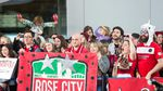 The Rose City Riveters erupt into cheers as the Portland Thorns emerge from the Portland International Airport Sunday, Oct. 15, 2017.