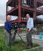 Oregon Field Guide producer Ed Jahn, right, with Oregon Public Broadcasting videographer Todd Sonflieth in front of the destroyed disaster prevention building in Minamisanriku, Japan, 2014. The building was destroyed during the March 11, 2011 earthquake and tsunami in that region.