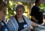 Kate Zeller Lamb, a lifelong Maywood Park resident, serves hotdogs at the annual National Night Out event at the Maywood Commons on Saturday, July 27, 2019, in Maywood Park, Ore.
