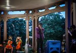 Artist and poet, Tazha Williams, performs spoken word on top of a musical bed of stringed instruments playing at the violin vigil for Elijah McClain at Peninsula Park in Portland, Ore., Friday, July 3, 2020.