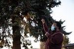 """Kenny Adams implores a small crowd gathered for a healing circle in Bend, Ore., Tuesday, April 20, 2021, to stay engaged in social justice movements following the conviction of former police officer Derek Chauvin for murdering George Floyd. """"This is where the real work starts now,"""" Adams said."""