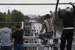 People watch from an overpass as protesters marching against racist violence and police brutality block traffic on Interstate 84 in Portland, Ore., on June 8, 2020.