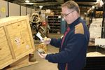Dan Rolince, U.S. Fish and Wildlife Service Office of Law Enforcement supervisor, inspects a bottle of snake wine. It's one of the 1.5 million pieces of wildlife trafficking evidence in the National Eagle and Wildlife Property Repository.
