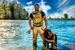 Chad Brown with his dog Axe on the Willamette River, Oregon.