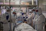A patient infected with COVID-19 is treated in one of the intensive care units (ICU) at the Severo Ochoa hospital in Leganes, outskirts of Madrid, Spain, Friday, Oct. 9, 2020. Spain has become the first western Europe to accumulate more than 1 million confirmed infections as the country of 47 million inhabitants struggles to contain a resurgence of the coronavirus.