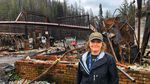 Jamee Savidge, outside the remnants of several Blue River businesses including the gas station.