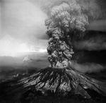 a giant plume of ash blasted out of the top of an erupting Mount St. Helens volcano.