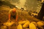 Gary Benthin works to shut off water to homes destroyed by the Santiam Fire near Gates, Ore., Sept. 9, 2020. Fires around Oregon could become the deadliest, costliest in state history.