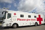 A mobile donation vehicle used by the American Red Cross. Red Cross implemented safety protocols for the pandemic, including spacing beds 6 feet apart, and requiring face masks and additional wipe-downs of donor areas.