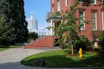 The Oregon Capitol sits just beyond Waller Hall on the campus of Willamette University in Salem, Ore., Wednesday, Aug. 7, 2019. The small private college was founded in 1842.