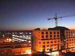 A construction crane is seen over downtown Bend in this 2009 file photo. Candidates for Bend City Council had a lot to say about the city's plans for dealing with tis rapid growth at a debate Monday, Oct. 3, 2016.