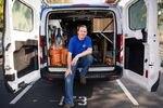 Mat Pergens sits in his work van. He repairs and installs garage doors.
