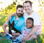 Ben West and Paul Rummell with their son JayQuan and their dog.
