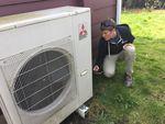 Peter Kernan of Enhabit checks the efficiency of a heat pump system.