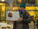 Children's author Eric Kimmel reads his book 'Hanukkah Bear' with illustrations by Mike Wohnoutka to kids celebrating at Director Park on Sunday, Dec. 22, 2019, in Portland, Ore.