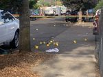 Numbers mark areas where law enforcement collected bullet casings and other evidence after an Aug. 10, 2021, shooting that left two people dead and four injured in Northeast Portland near the intersection of Fremont and 82nd Avenue.