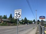 A white sign with black font showing the speed limit of 35 miles per hour on Northeast 82nd Avenue in Portland.