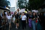 Demonstrators march down Broadway in Portland to call for the disarmament of PSU police.