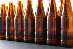 Seven Oregon breweries will be selling beer in reusable bottles with markings on the glass to indicate that they are refillable.