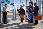 Rep. Tawna Sanchez (Shoshone-Bannock, Ute, Carrizo), center in burgundy, leads volunteers Lisa Graham (Comanche) and Gene Sanchez (Shoshone-Bannock, Ute, Carrizo) into Two Rivers Correctional Institute in Umatilla, Ore., for powwow Aug. 24, 2019.