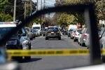 Police investigate the scene of a homicide in Oakland, Calif.